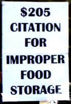 sign says $205 citation for improper food storage