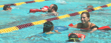 lifeguards and swimmers in two lanes