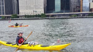 swimmer and kayaker in river